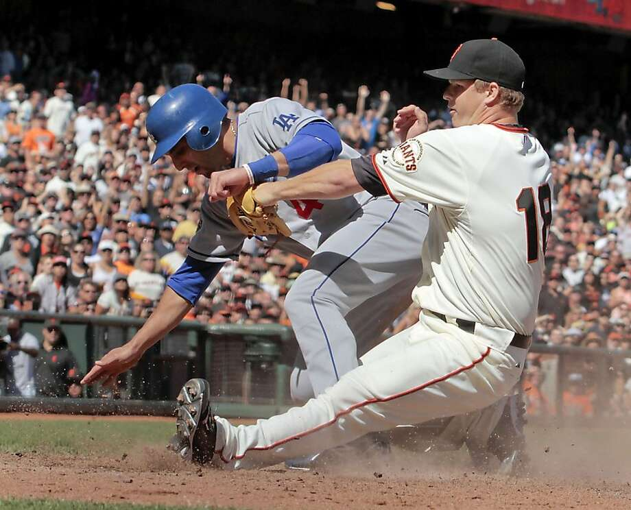 Dodger Alex Castellanos scores on a wild pitch as Giant's pitcher Matt Cain tries to tag him out inn the 8th inning at AT&T Park in San Francisco, Calif., on Saturday, September, 8th  2012. Photo: John Storey, Special To The Chronicle