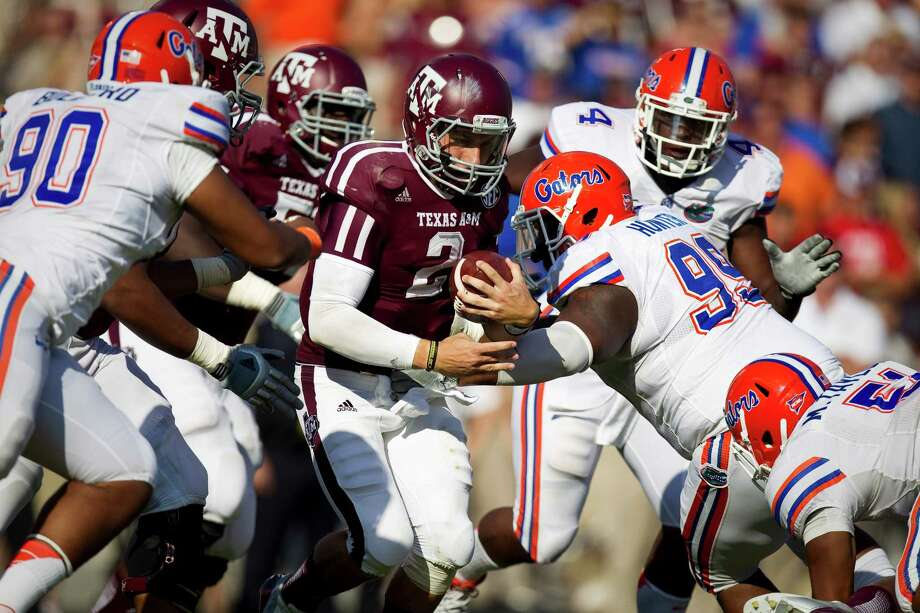 Johnny Manziel made his first Texas A&M start on Sept. 8, 2012, against Florida. He passed for 173 yards and ran for 60 yards and a touchdown. Florida won 20-17. Photo: Nick De La Torre, Houston Chronicle / © 2012  Houston Chronicle
