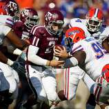 Texas A&M University quarterback Johnny Manziel (2) is forced to scramble as the University of Florida collapses on him during the fourth quarter of a NCAA football game, Saturday, Sept. 8, 2012, at Kyle Field in College Station. The University of Florida won 20-17.