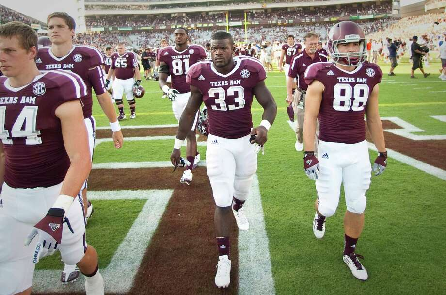 Texas A&M University running back Christine Michael (33) and the Texas A&M University football team walk off the field after loosing to University of Florida in a NCAA football game, Saturday, Sept. 8, 2012, at Kyle Field in College Station. The University of Florida won 20-17. Photo: Nick De La Torre, Houston Chronicle / © 2012  Houston Chronicle