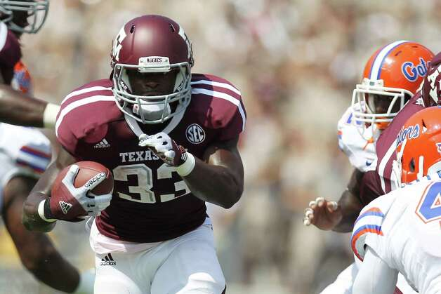Texas A&M University running back Christine Michael (33) finds room to run in the University of Florida defense during the first quarter of a NCAA football game, Saturday, Sept. 8, 2012, at Kyle Field in College Station. Photo: Nick De La Torre, Houston Chronicle / © 2012  Houston Chronicle