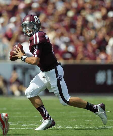 Texas A&M University quarterback Johnny Manziel (2) scrambles to find an open receiver during the fi