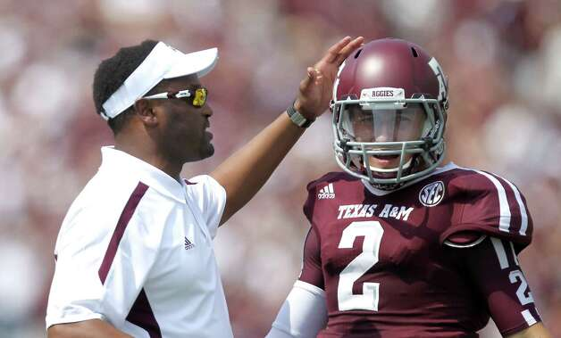 Texas A&M University head coach Kevin Sumlin pats Texas A&M University quarterback Johnny Manziel (2) after Manziel  was called for an illegal forward pass during the first quarter of a NCAA football game, Saturday, Sept. 8, 2012, at Kyle Field in College Station. Photo: Nick De La Torre, Houston Chronicle / © 2012  Houston Chronicle