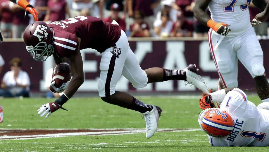 Texas A&M's Kenric McNeal (5) is tripped up by Florida's Jonathan Bostic (1) during the first quarter of an NCAA college football game, Saturday, Sept. 8, 2012, in College Station, Texas. Texas A&M begins a new era with its first Southeastern Conference game after leaving the Big 12 Conference. (AP Photo/David J. Phillip) Photo: David J. Phillip, Associated Press / AP