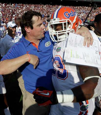 Florida coach Will Muschamp, left, celebrates their win with running back Mike Gillislee (23) after an NCAA college football game against Texas A&M, Saturday, Sept. 8, 2012, in College Station, Texas. Florida beat Texas A&M 20-17. (AP Photo/David J. Phillip) Photo: David J. Phillip, Associated Press / AP