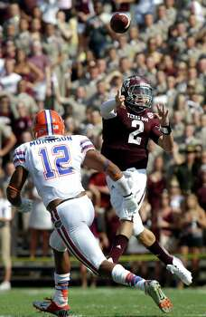 Texas A&M quarterback Johnny Manziel (2) throws a pass as Florida linebacker Antonio Morrison (12) defends during the second quarter of an NCAA college football game, Saturday, Sept. 8, 2012, in College Station, Texas. Texas A&M begins a new era with its first Southeastern Conference game after leaving the Big 12 Conference. (AP Photo/David J. Phillip) Photo: David J. Phillip, Associated Press / AP