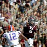Texas A&M quarterback Johnny Manziel (2) throws a pass as Florida linebacker Antonio Morrison (12) defends during the second quarter of an NCAA college football game, Saturday, Sept. 8, 2012, in College Station, Texas. Texas A&M begins a new era with its first Southeastern Conference game after leaving the Big 12 Conference. (AP Photo/David J. Phillip)