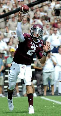 Texas A&M quarterback Johnny Manziel (2) throws a pass against Florida during the first quarter of an NCAA college football game, Saturday, Sept. 8, 2012, in College Station, Texas. Texas A&M begins a new era with its first Southeastern Conference game after leaving the Big 12 Conference. (AP Photo/Dave Einsel) Photo: Dave Einsel, Associated Press / FR43584 AP