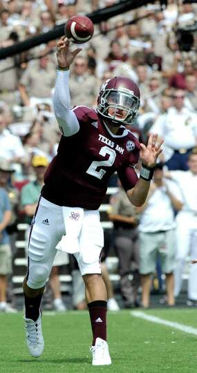 Texas A&M quarterback Johnny Manziel (2) throws a pass against Florida during the first quarter of a