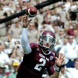 Texas A&M quarterback Johnny Manziel (2) throws a pass against Florida during the first quarter of an NCAA college football game, Saturday, Sept. 8, 2012, in College Station, Texas. Texas A&M begins a new era with its first Southeastern Conference game after leaving the Big 12 Conference. (AP Photo/Dave Einsel)