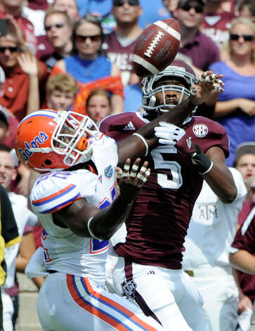 Florida defensive back Matt Elam, left, breaks up a pass intended for Texas A&M wide receiver Kenric McNeal (5) during then first quarter of an NCAA college football game, Saturday, Sept. 8, 2012, in College Station, Texas. Texas A&M begins a new era with its first Southeastern Conference game after leaving the Big 12 Conference. (AP Photo/Dave Einsel) Photo: Dave Einsel, Associated Press / FR43584 AP