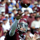 Texas A&M quarterback Johnny Manziel (2) throws a pass against Florida during the second quarter of an NCAA college football game, Saturday, Sept. 8, 2012, in College Station, Texas. Texas A&M begins a new era with its first Southeastern Conference game after leaving the Big 12 Conference. (AP Photo/Dave Einsel)