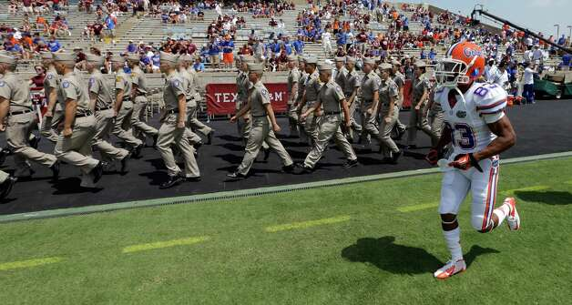 Florida wide receiver Solomon Patton (83) runs onto the field as members of the Texas A&M Corps of Cadets enter Kyle Field before an NCAA college football game, Saturday, Sept. 8, 2012, in College Station, Texas. Texas A&M begins a new era with its first Southeastern Conference game after leaving the Big 12 Conference. (AP Photo/David J. Phillip) Photo: David J. Phillip, Associated Press / AP