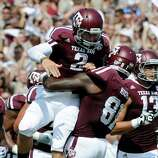 Texas A&M quarterback Johnny Manziel (2) is lifted by Nehemiah Hicks (81) after rushing for a touchdown against Florida during the second quarter of an NCAA college football game, Saturday, Sept. 8, 2012, in College Station, Texas. Texas A&M begins a new era with its first Southeastern Conference game after leaving the Big 12 Conference. (AP Photo/Dave Einsel)