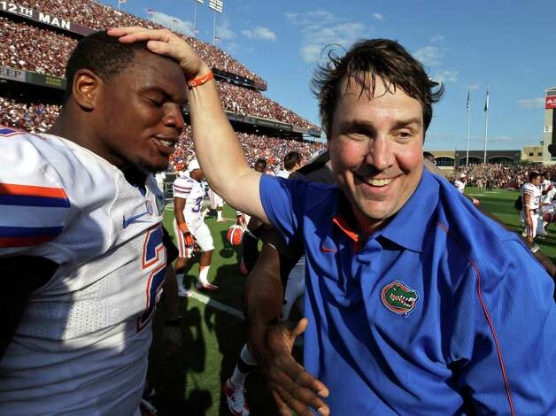 Florida coach Will Muschamp, right, celebrates their win with defensive lineman Dominique Easley (2) after an NCAA college football game against Texas A&M, Saturday, Sept. 8, 2012, in College Station, Texas. Texas A&M begins a new era with its first Southeastern Conference game after leaving the Big 12 Conference. Florida beat Texas A&M 20-17. (AP Photo/David J. Phillip) Photo: David J. Phillip, Associated Press / AP
