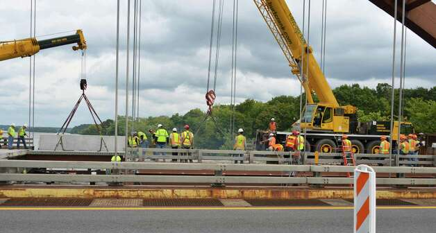 Crews begin their work on the Northway's Twin Bridges Saturday Sept. 8, 2012. (John Carl D'Annibale / Times Union) Photo: John Carl D'Annibale