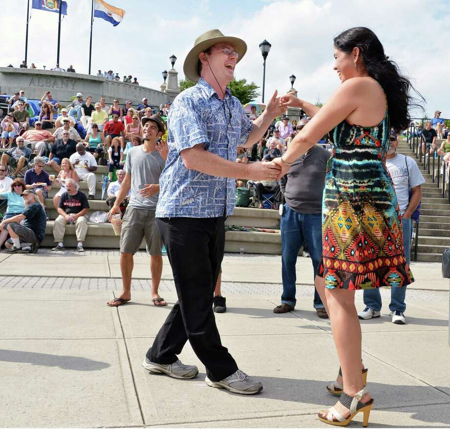 Francis Wilkin and Lucina Torres, both of Schenectady dance during the 11th Annual Albany Riverfront Jazz Festival at the Corning Preserve in Albany's Riverfront Park Saturday Sept. 8, 2012.  (John Carl D'Annibale / Times Union) Photo: John Carl D'Annibale / 00019188A