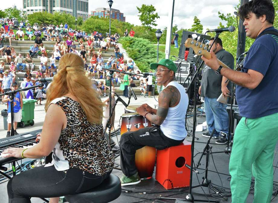 NYC Afro-Cuban stars the Pedrito Martinez Group performs during the 11th Annual Albany Riverfront Jazz Festival at the Corning Preserve in Albany's Riverfront Park Saturday Sept. 8, 2012.  (John Carl D'Annibale / Times Union) Photo: John Carl D'Annibale / 00019188A