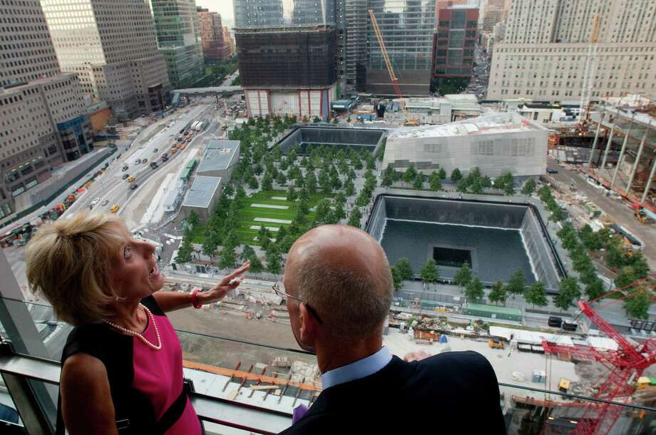 Karen Eckert, left, of Williamsville, N.Y., talks with Scott Maurer of Moore, S.C., as they look over the National September 11 Memorial and Museum at the World Trade Center, Thursday, Sept. 6, 2012 in New York. Eckert lost her brother-in-law, Sean Rooney, in the attacks of Sept. 11, 2001. Eckert and Maurer are part of the September 11th Education Trust, a non-profit organization dedicated to teaching the lessons of 9/11. (AP Photo/Mark Lennihan) Photo: Mark Lennihan
