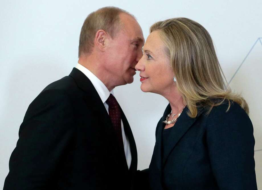 Russian President Vladimir Putin, left, meets U.S. Secretary of State Hillary Rodham Clinton on her arrival at the APEC summit in Vladivostok, Russia, Saturday, Sept. 8, 2012. (AP Photo/Mikhail Metzel,Pool) Photo: Mikhail Metzel / AP