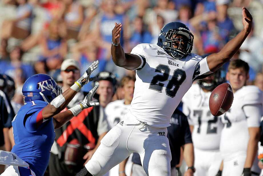 Rice 25, Kansas 24Kansas safety Lubbock Smith breaks up a pass intended for Rice running back Charles Ross (28) during the second half. Photo: Charlie Riedel, Associated Press / AP
