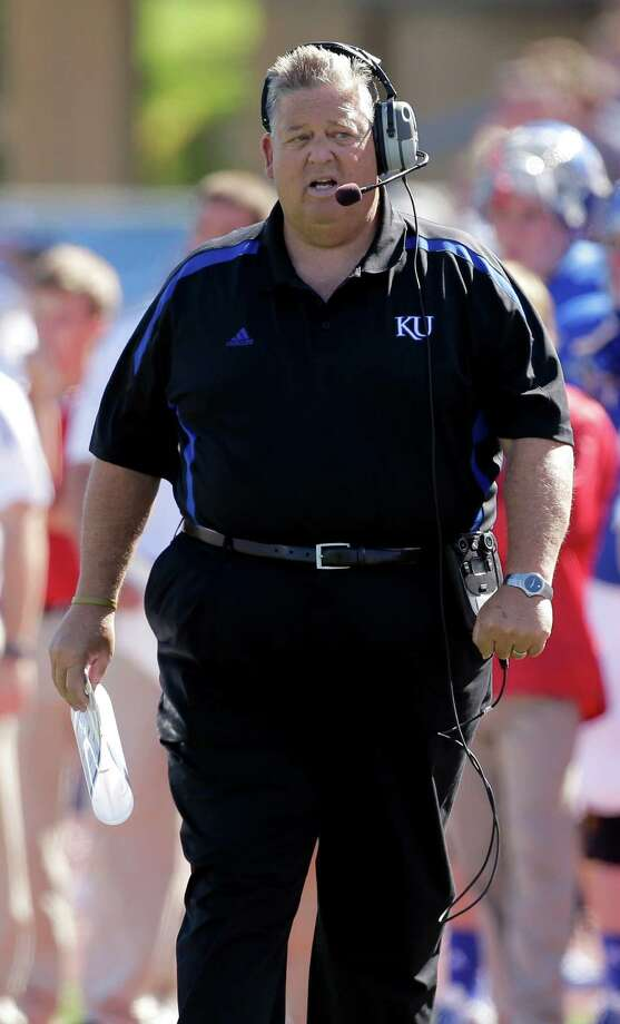 Kansas head coach Charlie Weis watches during the first half. Photo: Charlie Riedel, Associated Press / AP