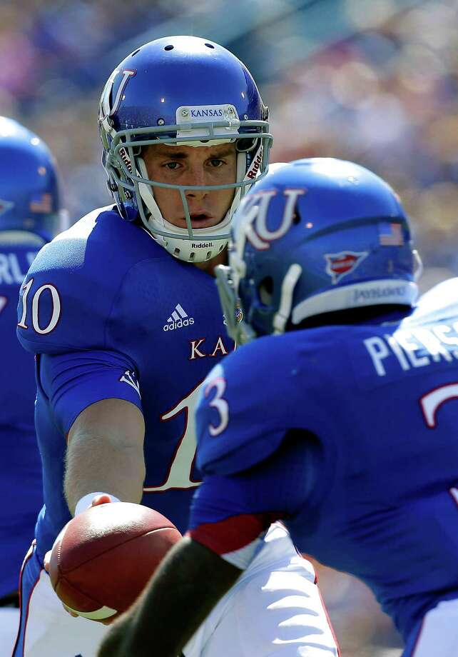 Kansas quarterback Dayne Crist (10) hands off the ball to running back Tony Pierson (3) during the first half. Photo: CharlIE Riedel, Associated Press / AP