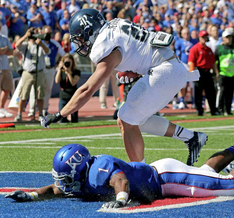 Rice running back Turner Petersen (26) gets past Kansas safety Lubbock Smith (1) to score a touchdown during the first half. Photo: Charlie Riedel, Associated Press / AP