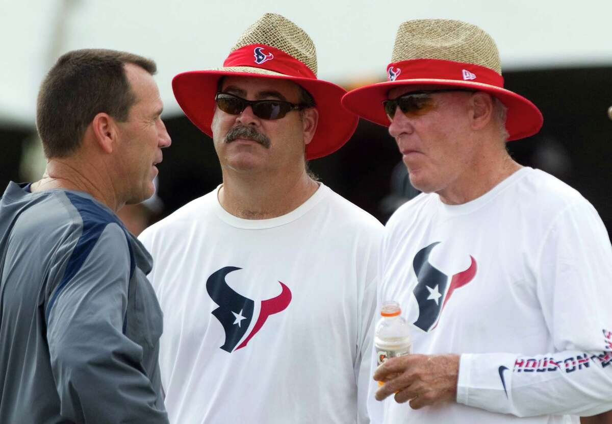 Texans COO Cal McNair, center, and his father Bob, the team's owner, right, will offer their input to coach Gary Kubiak, left, but don't like to step on his toes.