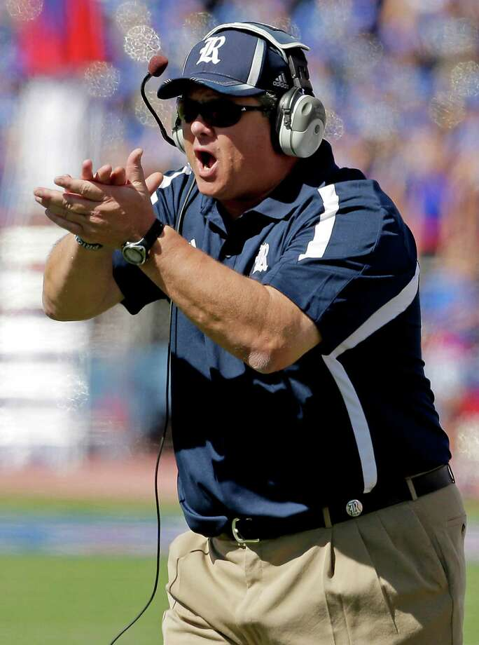 Rice head coach Larry Hoeffer yells from the sideline during the first half. Photo: Charlie Riedel, Associated Press / AP
