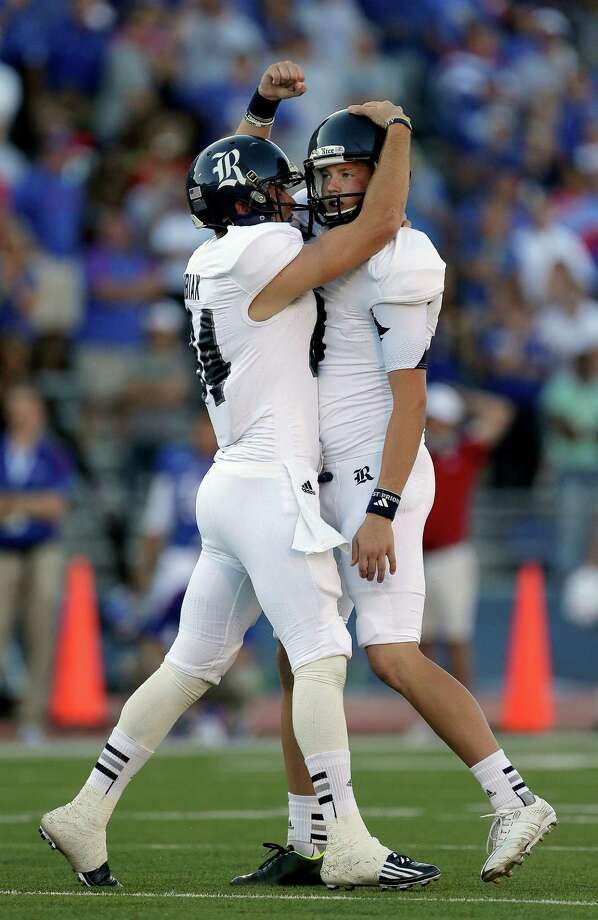 Rice kicker Chris Boswell, right, celebrates with wide receiver Klein Kubiak after he kicked a 45-yard field goal to win an NCAA college football game against Kansas Saturday, Sept. 8, 2012, in Lawrence, Kan. Rice won the game 25-24. (AP Photo/Charlie Riedel) Photo: Charlie Riedel, Associated Press / AP