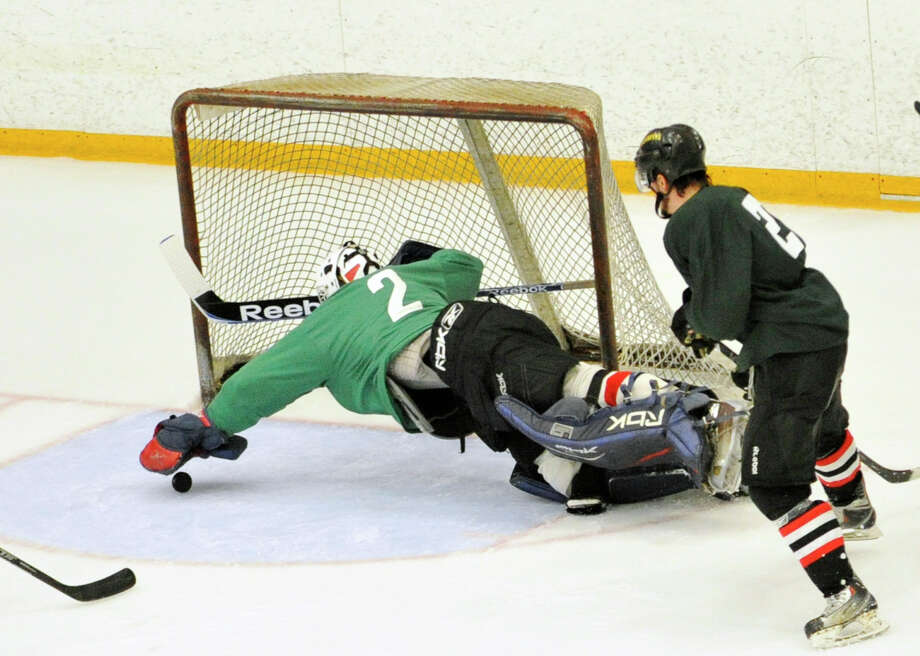 Goalie Travis Hall dives for the puck during the Danbury Whalers' annual Green and White Game at Danbury Ice Arena on Saturday, Sept. 8, 2012. Photo: Jason Rearick / The News-Times