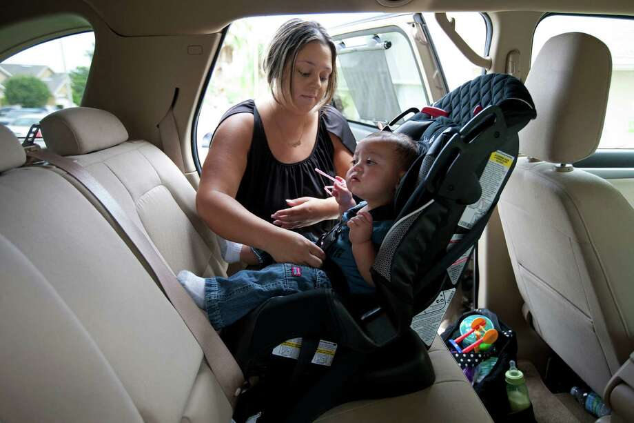 Amanda Cordeiro, a single mother who owes $55,000 in student loans and has fielded as many as seven phone calls a day from debt collectors, buckles her son into his car seat in Groveland, Fla. Photo: Ruth Fremson, New York Times / NYTNS