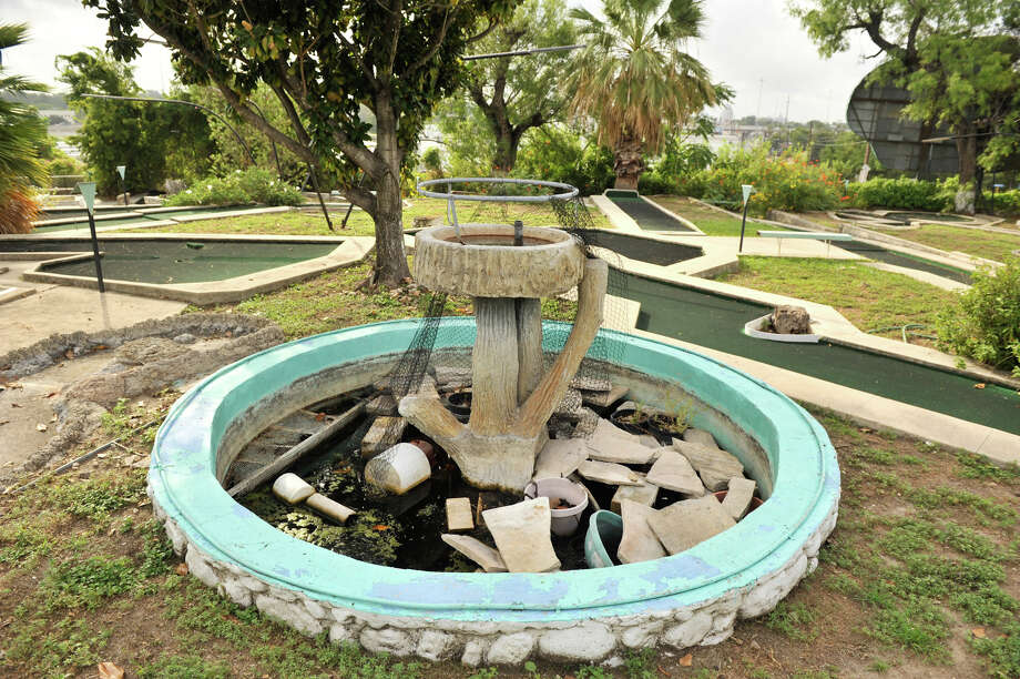 Debris sits in the fountain at the closed Cool Crest miniature golf course on Fredericksburg Road. Aug. 25, 2012. Photo: Robin Jerstad,  For The Express-News
