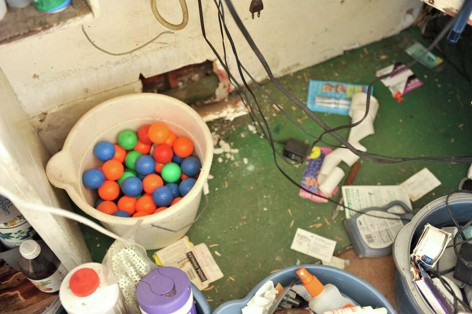 A bucket of multi-colored golf balls sits in the office of the closed Cool Crest miniature golf course on Fredericksburg Road on Aug. 25, 2012. Photo: Robin Jerstad,  For The Express-News