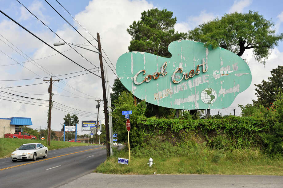 An aging art-deco sign for the Cool Crest miniature golf course is still visible along Fredericksburg Road. Aug. 25, 2012. Photo: Robin Jerstad,  For The Express-News