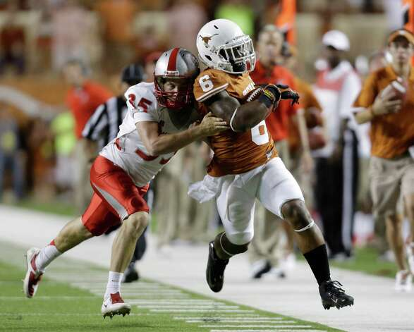 Texas' Quandre Diggs (6) is hit by New Mexico's Ben Skaer (35) on a punt-return during the second quarter of an NCAA college football game on Saturday, Sept. 8, 2012, in Austin, Texas. (AP Photo/Eric Gay) Photo: Eric Gay, Associated Press / AP