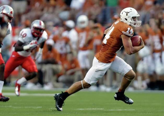 Texas quarterback David Ash (14) scores a rushing touchdown against New Mexico during the first quarter of an NCAA college football game on Saturday, Sept. 8, 2012, in Austin, Texas. (AP Photo/Eric Gay) Photo: Eric Gay, Associated Press / AP