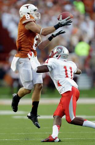Texas receiver Jaxon Shipley (8) reaches for a pass over New Mexico defender Destry Berry (11) during the first quarter of an NCAA college football game on Saturday, Sept. 8, 2012, in Austin, Texas. Shipley dropped the pass. (AP Photo/Eric Gay) Photo: Eric Gay, Associated Press / AP