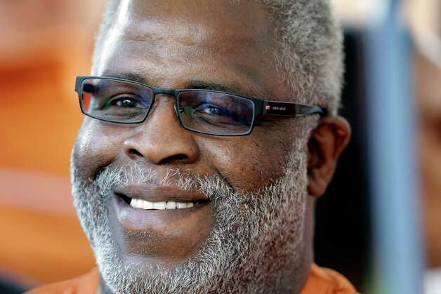 Former Texas football player Earl Campbell prepares to take part in the coin flip before an NCAA college football game against New Mexico, Saturday, Sept. 8, 2012, in Austin, Texas. (AP Photo/Eric Gay) Photo: Eric Gay, Associated Press / AP