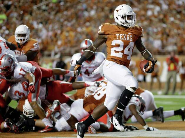 Texas' Joe Bergeron (24) scores a touchdown against New Mexico during the third quarter of an NCAA college football game on Saturday, Sept. 8, 2012, in Austin, Texas. (AP Photo/Eric Gay) Photo: Eric Gay, Associated Press / AP