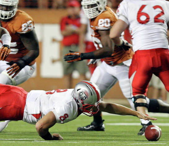 New Mexico Lobos' Cole Gautsche grabs for a fumble against the Texas Longhorns during first half action Saturday Sept. 8, 2012 at Texas Memorial Stadium in Austin, Tx. Photo: Edward A. Ornelas, Express-News / © 2012 San Antonio Express-News