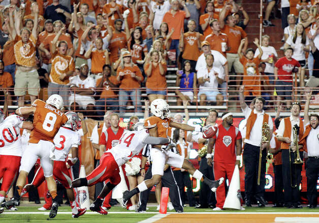 Texas Longhorns' Mike Davis scores a touchdown around New Mexico Lobos' Joseph Harris during first half action Saturday Sept. 8, 2012 at Texas Memorial Stadium in Austin, Tx. Photo: Edward A. Ornelas, Express-News / © 2012 San Antonio Express-News