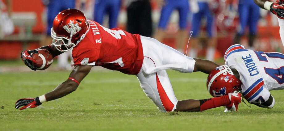 Houston wide receiver Ronnie Williams (4) is tripped up by Louisiana Tech safety Javontay Crowe (47) during the first quarter in an NCAA football game at Robertson Stadium, Saturday, Sept. 8, 2012, in Houston. Photo: Brett Coomer, Houston Chronicle / © 2012  Houston Chronicle