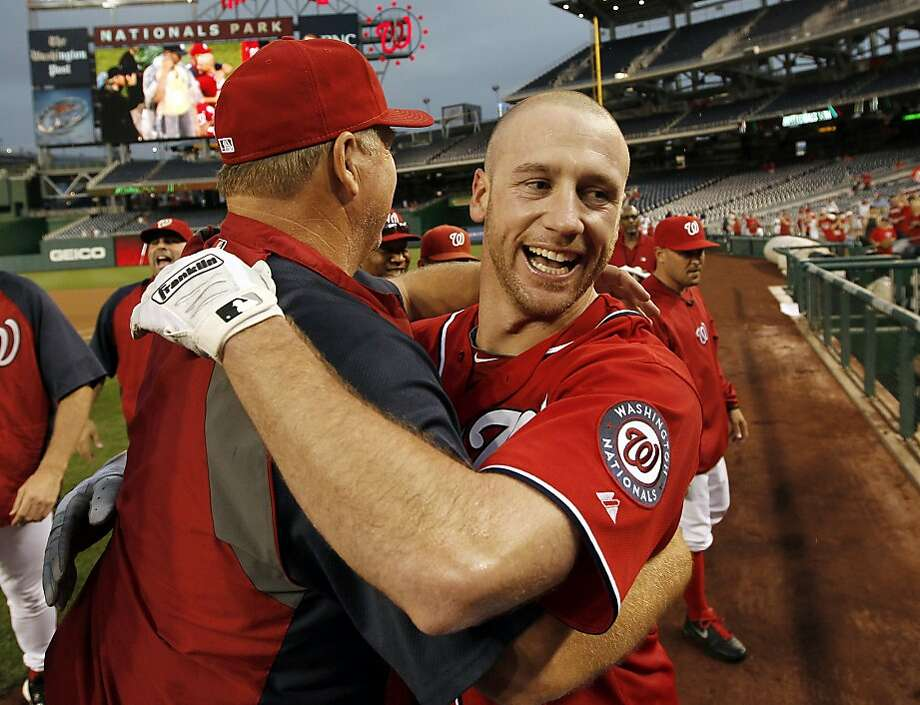 Washington Nationals' Corey Brown, right, celebrates with pitching coach Steve McCatty after Brown hit a single to score the winning run in a baseball game against the Miami Marlins at Nationals Park Saturday, Sept. 8, 2012, in Washington. The Nationals won 7-6 in 10 innings. (AP Photo/Alex Brandon) Photo: Alex Brandon, Associated Press