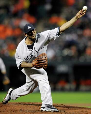 New York Yankees starting pitcher CC Sabathia delivers against the Baltimore Orioles during the first inning of a baseball game, Saturday, Sept. 8, 2012, in Baltimore. (AP Photo/Nick Wass) Photo: Nick Wass
