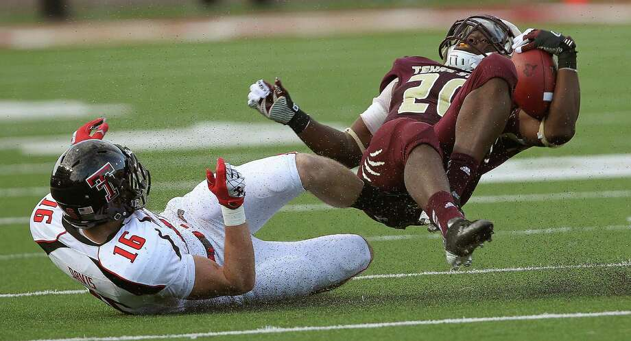 Texas Tech brought Texas State back to earth, with Cody Davis performing that task on the Bobcats' Terrence Franks on this play. Photo: Stephen Spillman / Lubbock Avalanche-Journal
