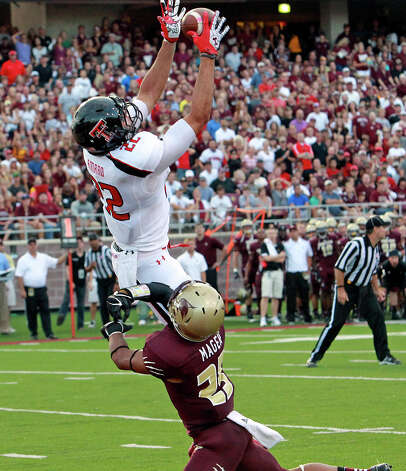 Jace Amaro hauls in a touchdown pass for the Red Raiders as Texas State hosts Texas Tech at Bobcat Stadium on September 8, 2012. Photo: Tom Reel, Express-News / ©2012 San Antono Express-News