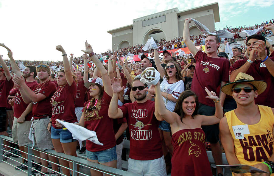 Bobcat fans celebrate the first touchdown in their new stadium as Texas State hosts Texas Tech at Bobcat Stadium on September 8, 2012. Photo: Tom Reel, Express-News / ©2012 San Antono Express-News