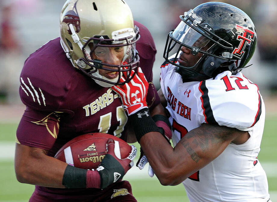 Bobcat receiver Tim Hawkins is forced out of bounds by D.J. Johnson as Texas State hosts Texas Tech at Bobcat Stadium on September 8, 2012. Photo: Tom Reel, Express-News / ©2012 San Antono Express-News